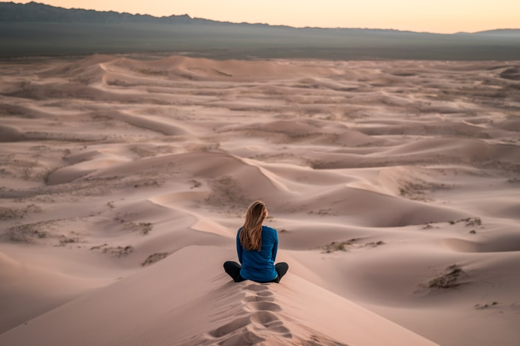 Woman at the desert. Source: Unsplash