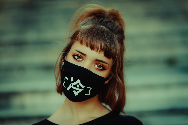 Woman wearing a mask, fashion post COVID-19. Source: Unsplash