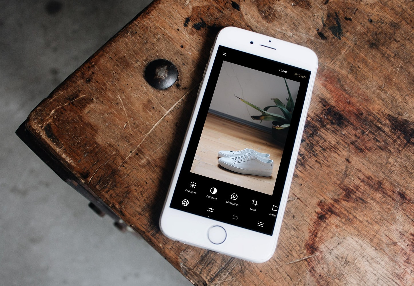 Mobile showing pair of shoes. Source: Unsplash